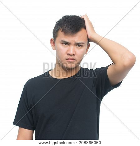 young asian man with thoughtful expression scratching his head in thought and posing for portrait isolated on white background with clipping path