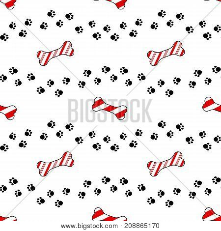 Cute cartoon seamless pattern design. Dog paw print trails and candy cane in shape of bone biscuit treat.