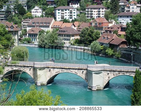 BERN BERNE SWITZERLAND bridge over clean alpine Aare river with clean water and cityscape landscape of historical houses on bank in swiss capital city in warm sunny summer day EUROPE on JULY