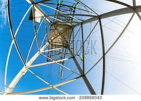 Inside view of the structure under power transmission tower. High voltage electric tower