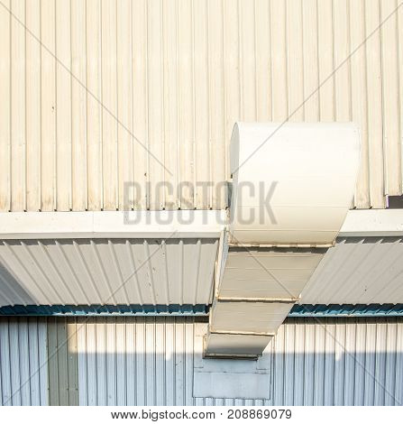 Air passage tube metal sheet on roof of factory.