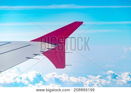 Aerial View Of Cloud And Sky And Land With Airplane Wing From Airplane Window ,traveling Concept