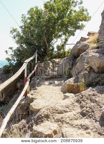 Fencing along the stone path. Travel along the coast along the path of Prince Golitsyn.