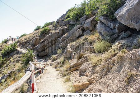 New World, Crimea - 12 July, Layered rock along the path, 12 July, 2017. Travel along the coast along the path of Prince Golitsyn.