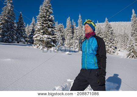 Traveler Enjoying Life In Winter Mountains