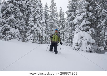 Happy Traveler, With Backpack, Is Walking In Deep Snow