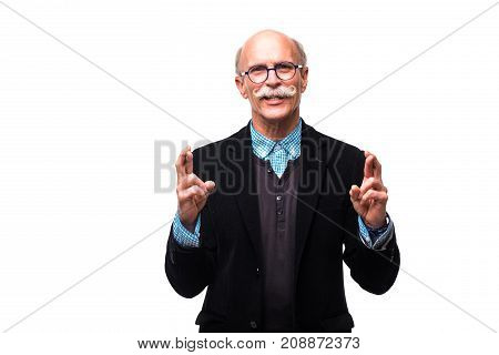 Closeup Portrait Of Senior Mature Man Crossing Fingers Wishing And Praying For Miracle, Hoping For T