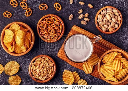Beer With Snacks On Stone Background.