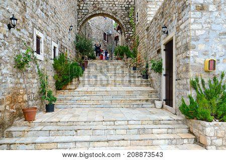 ULCINJ MONTENEGRO - SEPTEMBER 9 2017: Unknown tourists photograph urban view on street of Old Town Ulcinj Montenegro