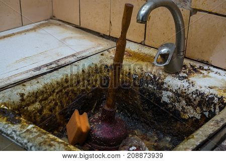 old clogged a sink in the rust the old kitchen clogged sink