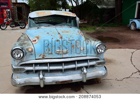 Seligman, Arizona, Usa - July 24, 2017: Rusty abandoned Chevrolet car in Seligman, Arizona.