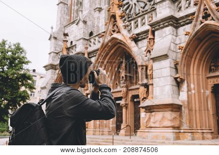 A good and nice picture of a traveller shooting the old church. He hasn't seen the building like that never before so that's why he is impressed and wants to take more pictures of this building. Cut view