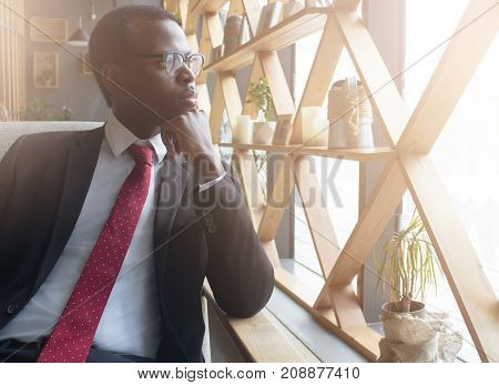 Horizontal Closeup Of Handsome African American Business Man Spending Leisure Time Indoors In Coffee