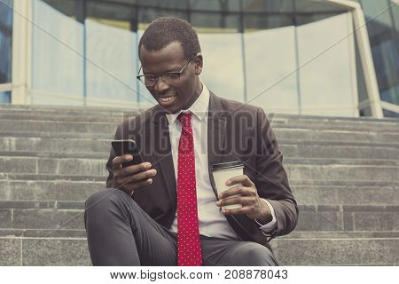 Urban Photo Of Young Handsome African American Business Guy Spending Leisure Time On Stairs In Stree