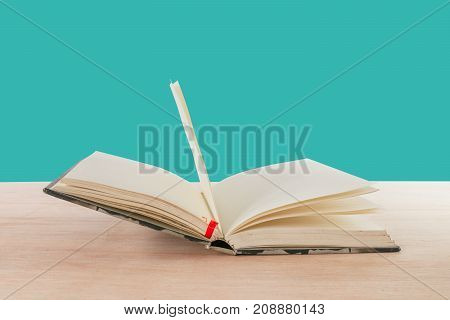 open book old on wooden floor isolated on blue background with copy space add text ( high definition image )