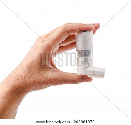 Hand holding asthma inhaler isolated on a white background. save clipping path.