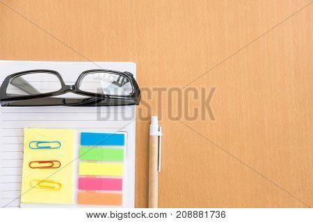 Sticky Note, Ballpoint Pen, Empty Notebook, Eyeglasses On Office Desk. Business, Education Concept.
