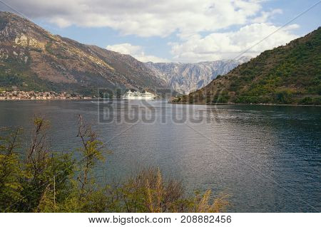Montenegro. View of the Bay of Kotor with cruise ship sailing to Kotor city