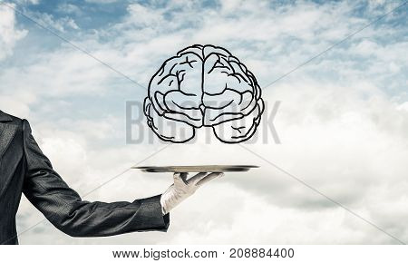 Cropped image of waitress's hand in white glove presenting sketched brains on metal tray with cloudy skyscape on background. 3D rendering.