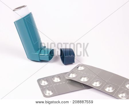 Inhaler to treat asthma on a white background.