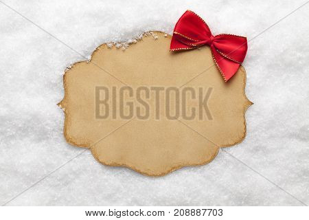 Blank Paper Card And Red Bow On Snow