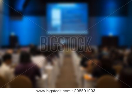 People Listen To Presentation In Conference Hall. Audience In Meeting Room. Participant Sitting In L