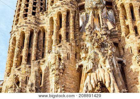 BARCELONA, SPAIN - August 17, 2017: Close-up view on the famous unfinished Roman Catholic church Sagrada Familia in Barcelona, designed by Catalan architect Antoni Gaudi