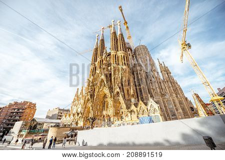 BARCELONA, SPAIN - August 17, 2017: Morning view on the famous unfinished Roman Catholic church Sagrada Familia in Barcelona, designed by Catalan architect Antoni Gaudi