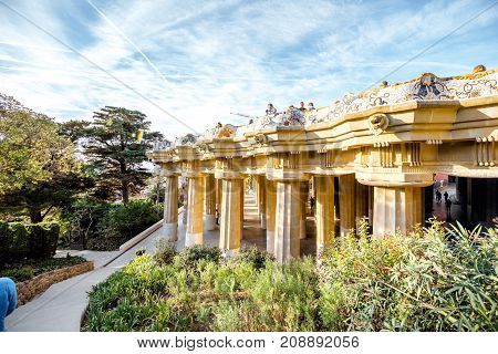 BARCELONA, SPAIN - August 17, 2017: View on the main terrace full of tourists in Guell park famous public park with gardens and architectonic elements designed by catalan architect Antoni Gaudi