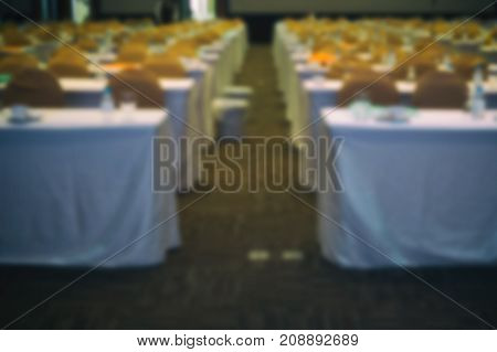 Modern Conference Hall Interior With Chairs. Seminar Room With Empty Seat. Business Event. Blur For
