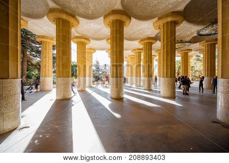 BARCELONA, SPAIN - August 17, 2017: View on the columns of the main terrace in Guell park, famous public park with gardens and architectonic elements designed by Antoni Gaudi in Barcelona