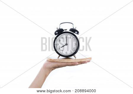 woman hand with a tray and clock alarm on white background meal time and healthy concept