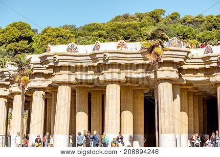 View on the main terrace with columns in Guell park during the morning light in Barcelona