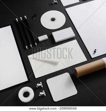Set of blank stationery elements on black paper background. Branding template. Mock-up for your design.
