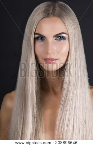 Scandinavian girl with perfect smooth grey hair smiling