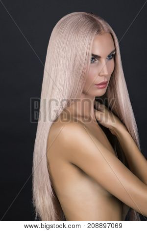 Doll looking model. Long cold pink smooth hair. Posing in studio nacked.