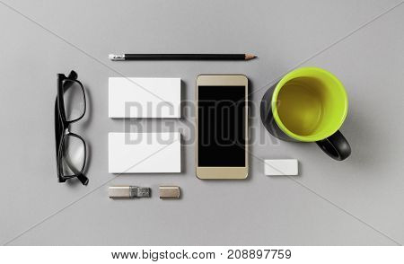 Photo of blank stationery set. Corporate identity template on gray paper background. Template for placing your design. Top view.