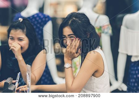 BALI, INDONESIA - OCTOBER 12, 2017: Two young asian women in the shopping mall.