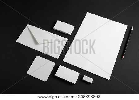 Template for branding identity. Blank stationery set on black paper background. Objects for placing your design.