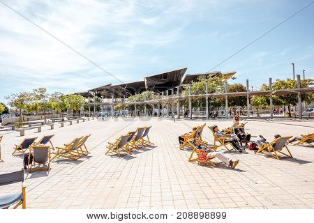 BARCELONA, SPAIN - August 16, 2017: Terrace with sunbeds of Design Museum, center of Barcelonas Institute of Culture located on Glories square in Barcelona
