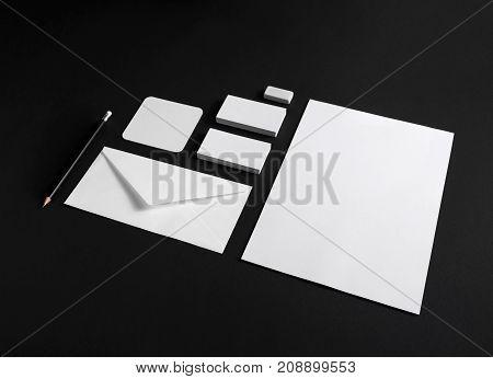 Branding identity mock-up. Blank corporate stationery set on black paper background. Mockup business template.