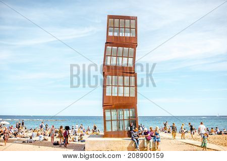 BARCELONA, SPAIN - August 16, 2017: El lucero herido metallic cubic sculpture by artist Rebecca Horn at Barceloneta beach