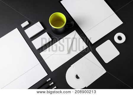 Blank stationery set on black paper background. Corporate ID mockup. Mock up for branding identity. Responsive design template.