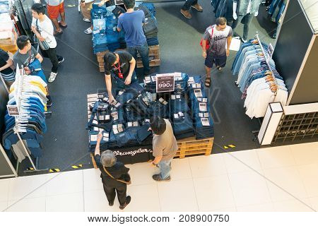 Mega Bangna Shopping Center Bangkok Thailand - October 7 2017: People pay attention to the clothing brand names at discounted prices. The exhibition is on sale in the store are very popular at the end of the month and payday.