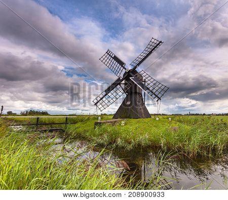 Wooden Windmill In Polder