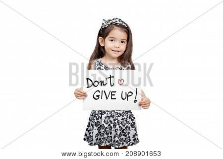 Giving encouragement concept Cute girl holding a dont give up sign standing on white background. Cute mixed race girl half Thai half English model 3 years old.
