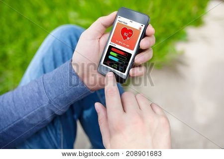 man holding phone with app health tracking activity screen on street