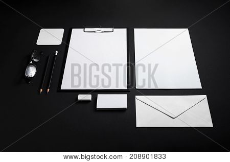 Blank corporate stationery. Branding mock-up on black paper background.