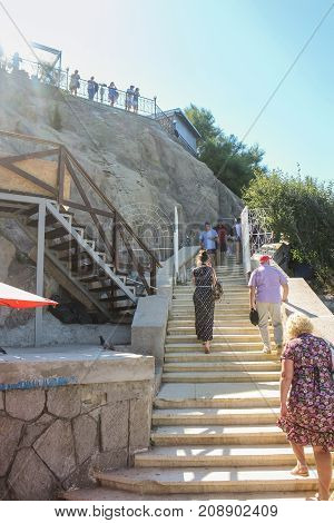 Yalta, Crimea - 11 July, People on the stairs, 11 July, 2017. Small Castle Lastochkino Nest and its surroundings.