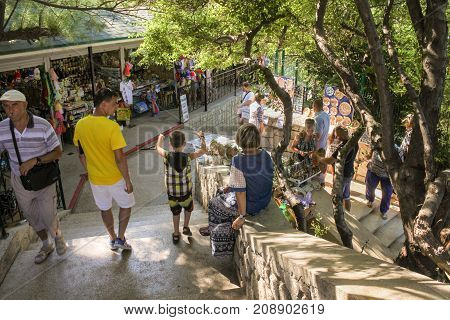Yalta, Crimea - 11 July, People at the souvenir pavilions, 11 July, 2017. Small Castle Lastochkino Nest and its surroundings.